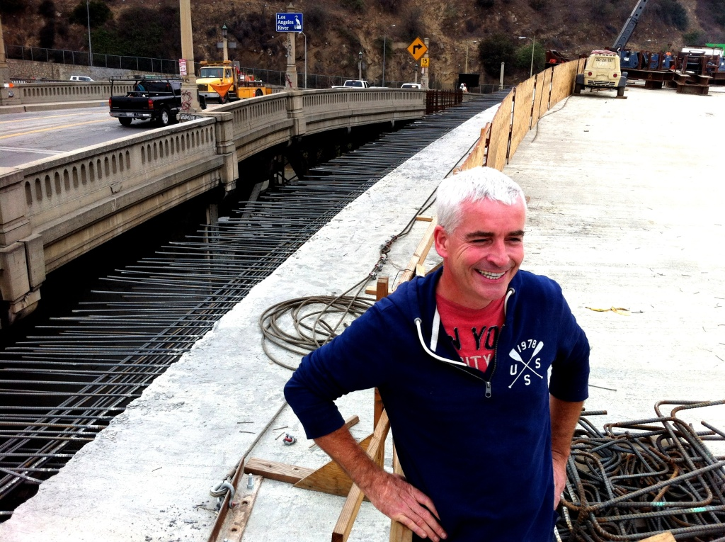 EnrichLA's Tomas O'Grady stands on the new LA River bridge that will join Figueroa St and Riverside Drive. He and others are trying to get the city to not demolish the historic bridge to the left, but turn it into a version of NYC's High Line, for pedestrians and bicyclists.