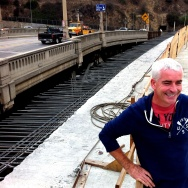 EnrichLA's Tomas O'Grady stands on the new LA River bridge that will join Figueroa St and Riverside Drive. He and others are trying to get the city to not demolish the historic bridge to the left, but turn it into a version of NYC's High Line, for pedestr