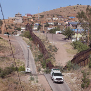 A U.S. Border Patrol agent drives along a fence which separates the cities of Nogales, Arizona and Nogales, Sonora Mexico. U.S. investigators are reconstructing the scene of an agent-involved shooting that killed 16-year-old Jose Antonio Elena Rodriguez in 2012, on the Mexican side of the fence. The teen's family has sued the U.S. government.