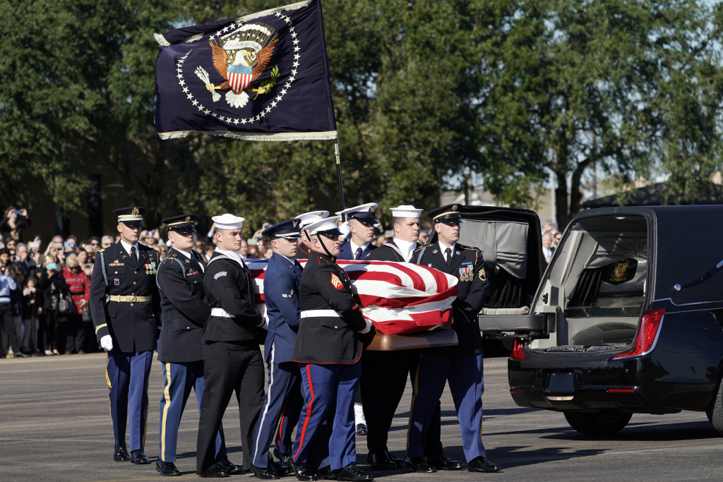 HOUSTON, TEXAS - DECEMBER 03:  Joint services military honor guard carry the flag-draped casket of the remains of President George H.W. Bush during a departure ceremony to Washington D. C at Ellington Field on December 3, 2018 in Houston, Texas.