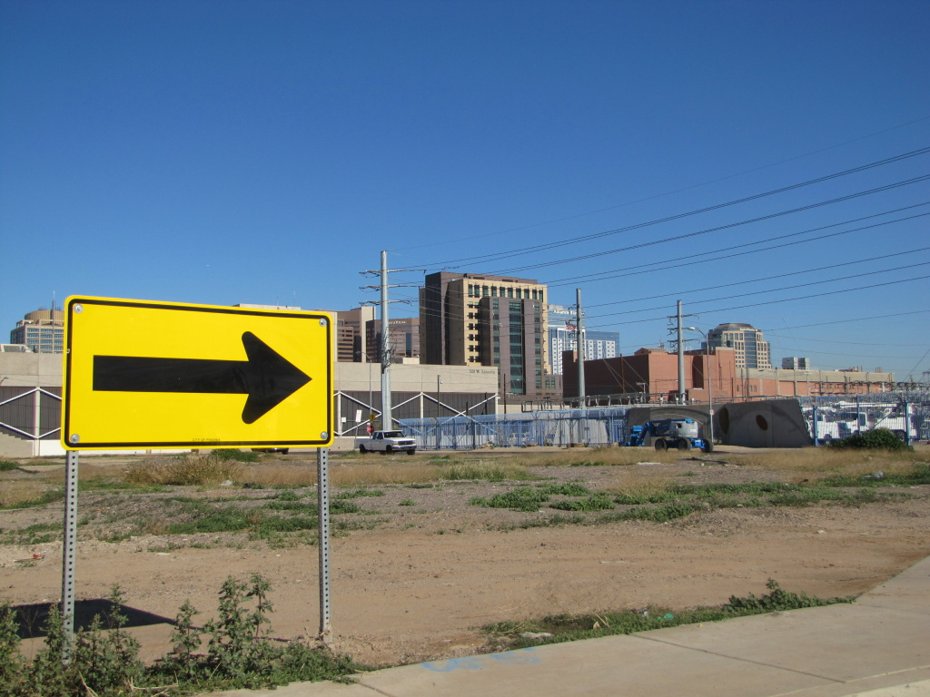 A proposed development in Phoenix would link the polished towers of downtown with the traditionally poor Grant Park neighborhood.