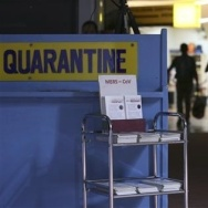In this photo from 2014, passengers walk past the Middle East respiratory syndrome quarantine area at Manila's International Airport in the Phillipines. The virus is now raising public concern in South Korea.