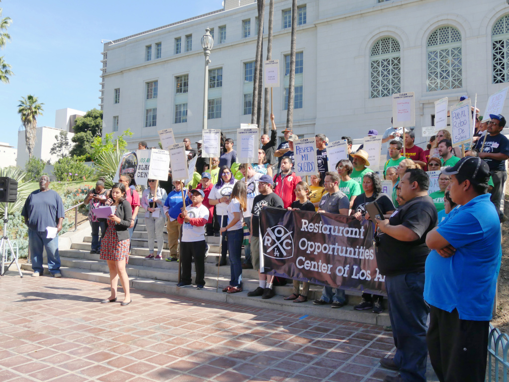 Dozens of workers rallied outside of Los Angeles City Hall on Tuesday morning, petitioning Mayor Eric Garcetti to pony up more funds to combat wage theft violations.