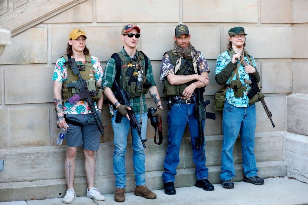 Armed protesters demonstrate during the Michigan Conservative Coalition organized