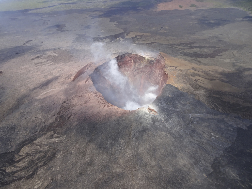 In this photo provided by the U.S. Geological Survey, the Puo Oo eruption site on Kilauea Volcano is shown in this July 2018 aerial image in Hawaii Volcanoes National Park. The volcano is no longer erupting, but is still active.