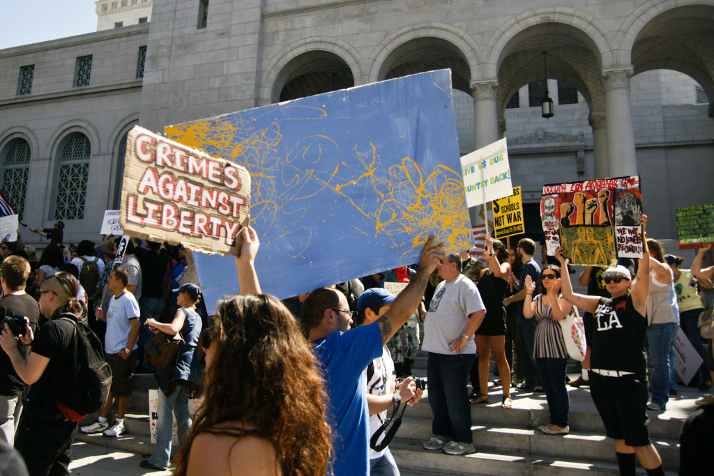 File photo: Participants in Occupy LA rally on the steps of City Hall after marching from Pershing Square. Mayor Villaraigosa now says the protestors have overstayed their welcome.