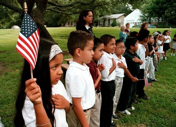 Latino elementary school students recite the Pledge of Allegiance during a September 11 memorial service in Tyler, Texas, 2003