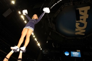 The Butler Bulldogs cheerleaders perform during a break in the game against the Connecticut Huskies during the National Championship Game of the 2011 NCAA Division I Men's Basketball Tournament.