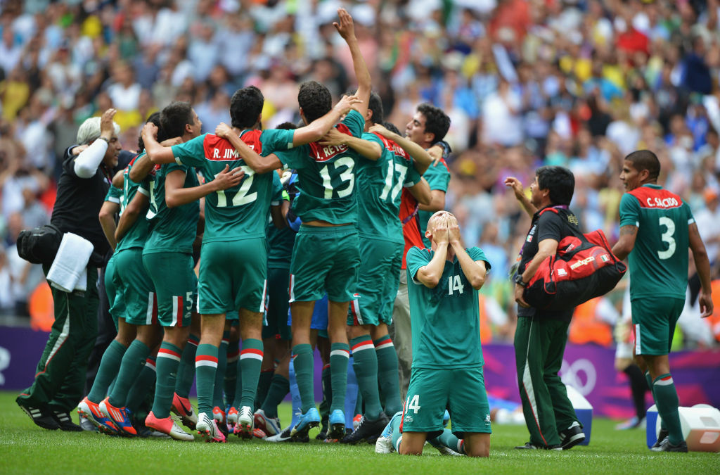 Jorge Enriquez of Mexico falls to the ground with jubilation as team-mates celebrate winning the gold medal after the Men's Football Final between Brazil and Mexico on Day 15 of the London 2012 Olympic Games at Wembley Stadium on August 11, 2012 in London, England.