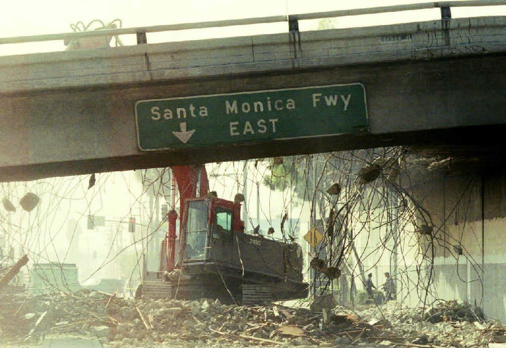 A bulldozer begins to tear down a section of the Santa Monica Freeway Jan. 19, 1994 that collapsed during the Northridge earthquake. Commuters were urged to leave for work two hours earlier due to the 300 foot section of the road that was closed.