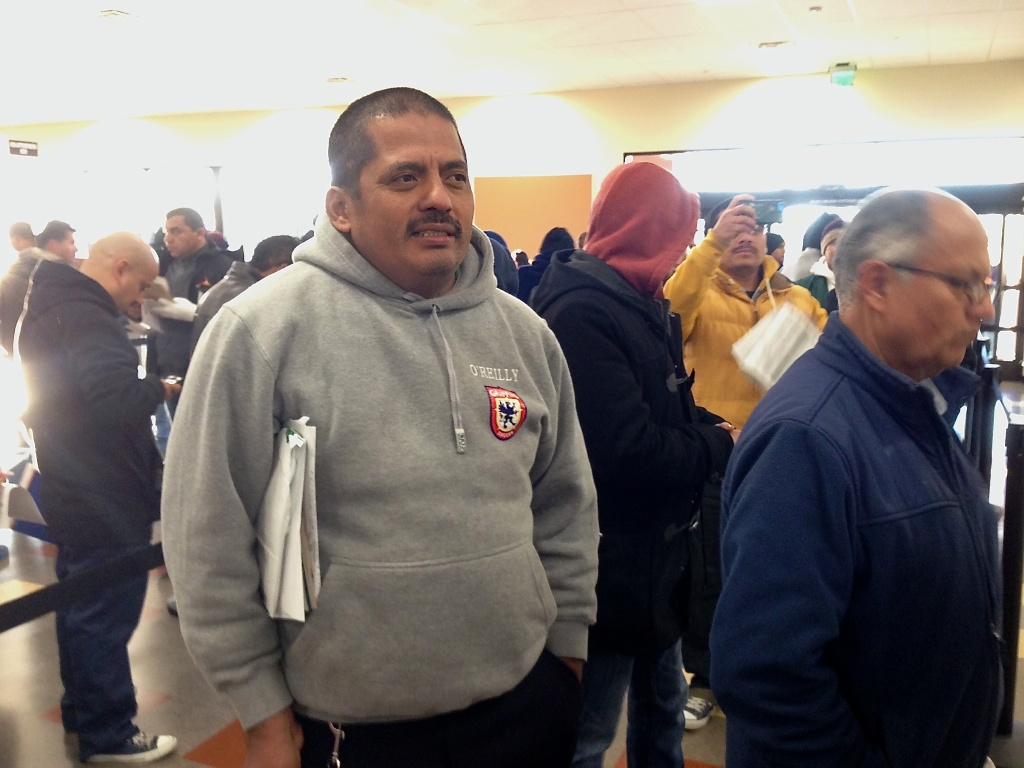 This file photo shows Guatemalan immigrant Carlos Barrera, who arrived at the Granada Hills DMV the night before to make sure he got an appointment to apply for an AB 60 driver's license. Overall, a total of about 236,000 immigrants in the country illegally began the application process during January, the state Department of Motor Vehicles said in a statement on Wednesday, February 18, 2015.