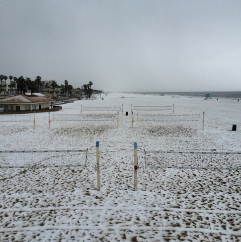 Huntington Beach in Orange County got turned into slush city Monday when pea-sized hail showered about an inch of hail slush at the beach around 10 a.m.