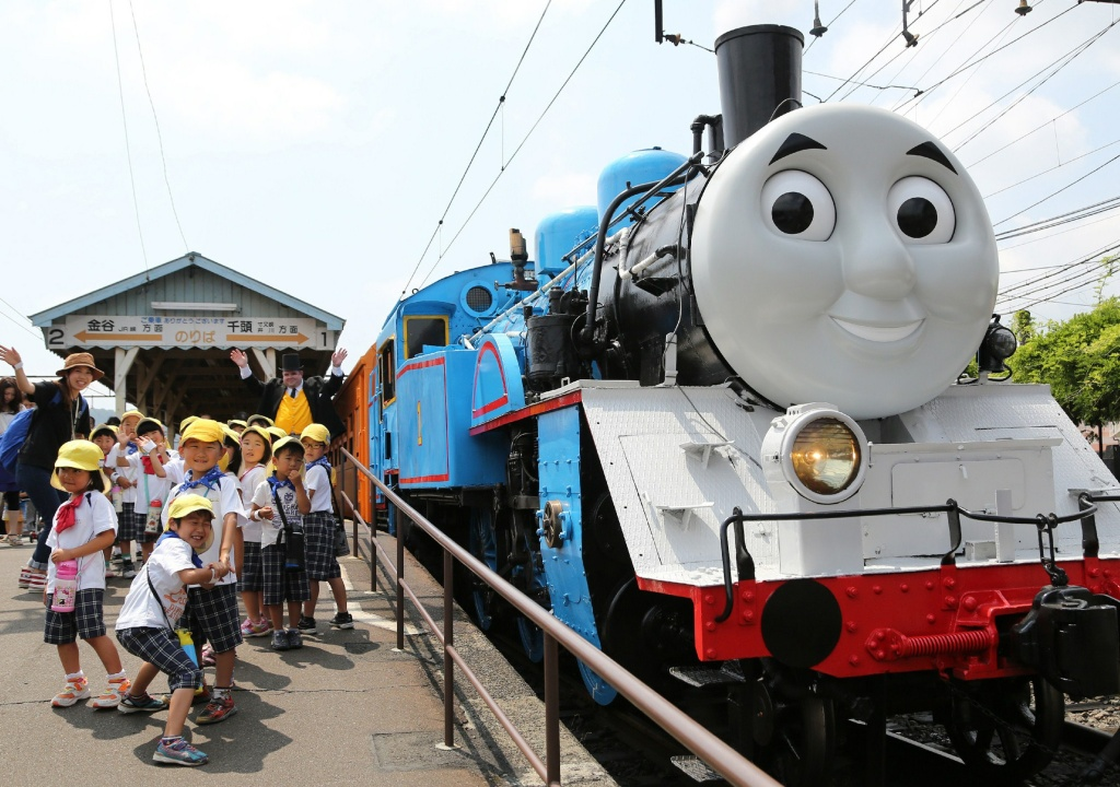 A life-sized Thomas the Tank Engine is surrounded by schoolchildren at Shinkanaya station along Japan's Oigawa railway, in the city of Shimada, west of Tokyo.