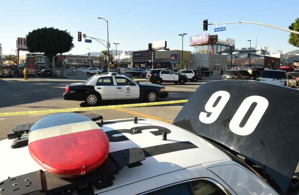 Los Angeles Police Department police cars fill the intersection outside a Jack in the Box restaurant in Hollywood, California, January 31, 2017.