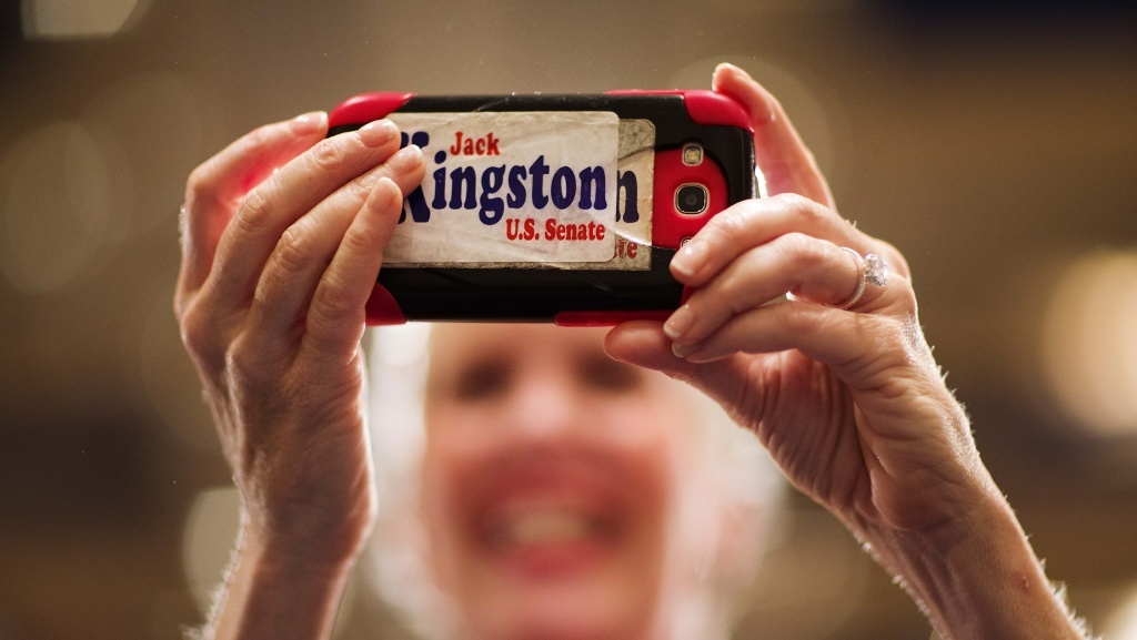 Laney Barroll Stark, of Savannah, Ga., took a picture with her cell phone as Rep. Jack Kingston, who ran for the Republican nomination for U.S. Senate in Georgia, addressed supporters at his primary runoff election night party in July.