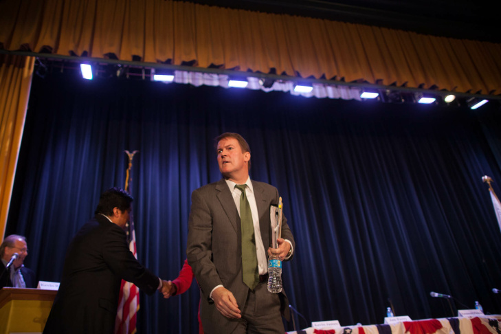 Kevin James looks for members of his staff after a candidate forum at John Burroughs Middle School in Hancock Park.