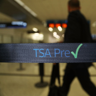 Travelers go through the TSA PreCheck security point at Miami International Airport on June 2, 2016 in Miami, Florida.