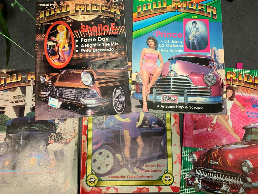 Collage of old Lowrider magazine issues.