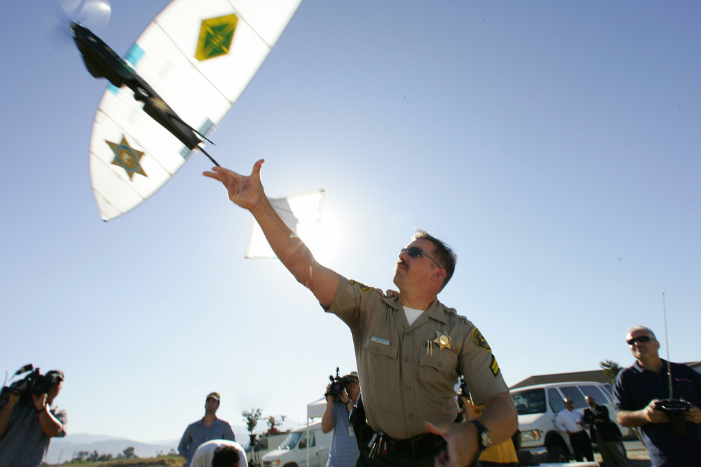 Deputy Troy Sella from the new technology department of the Los Angeles Sheriff's Department (LASD) launches the SkySeer Unmanned Arial Vehicle (UAV) drone, 16 June 2006 at a demonstration flight in Redlands, California. The LASD plans to purchase SkySeer drones to carry out surveillance and rescue operations. It will be the first time UAVs, long used by the military in war zones, will be used by law enforcement.