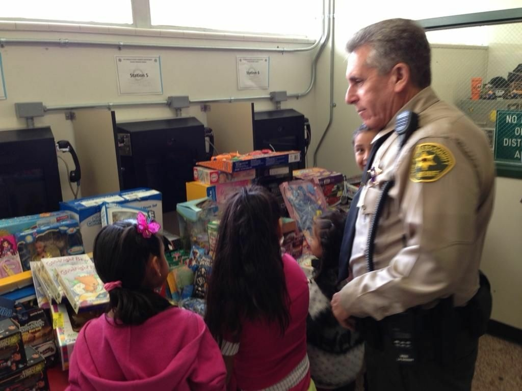 Children choose toys at the inaugural giveaway at the L.A Men's Central Jail. Deputies expected to 400 toys to be chosen by kids..