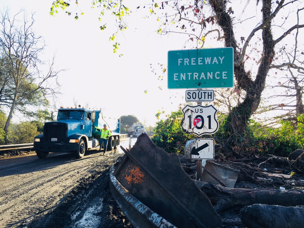 A dirt truck assists with the cleanup of the 101 Freeway on Thursday, Jan. 11, 2018, following the devastating mudslides that killed at least 20 people and destroyed dozens of homes in Santa Barbara County.