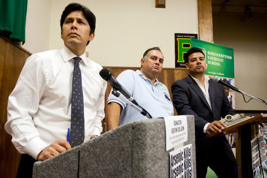 FILE: Senator Kevin De Leon (L) leads a community meeting about the future of Exide Technologies in Vernon on Tuesday, Oct. 8, 2013.