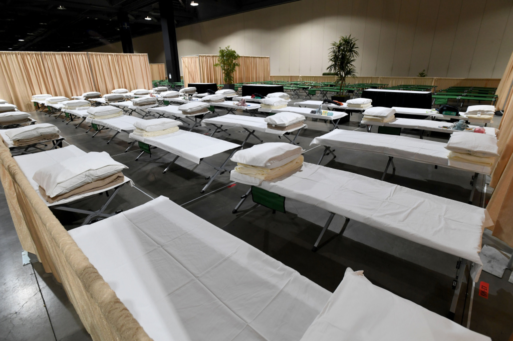 Sleeping quarters set up inside Exhibit Hall B for migrant children are shown during a tour of the Long Beach Convention Center on April 22, 2021 in in Long Beach, California.