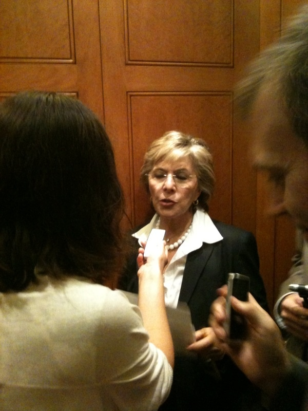 Barbara Boxer talking to reporters in elevator, August 5, 2010.