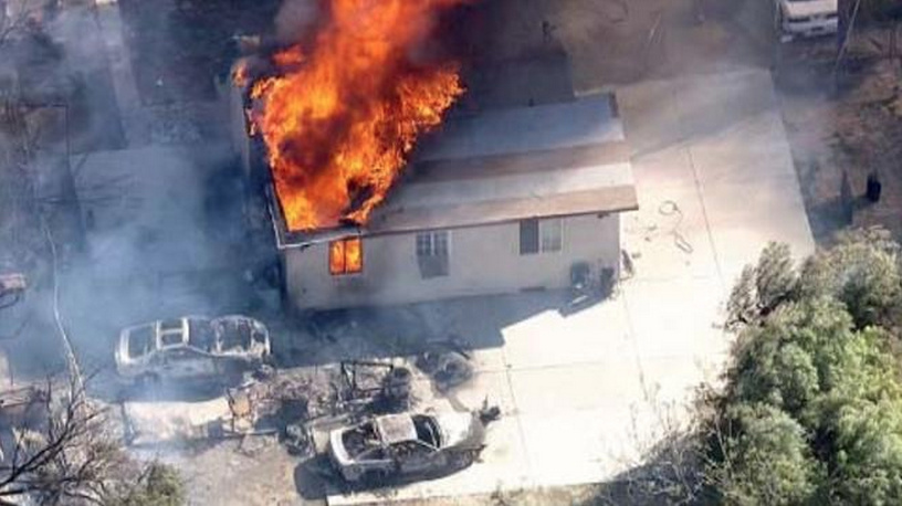 A fire in Jurupa Valley destroyed homes, structures and vehicles Tuesday.