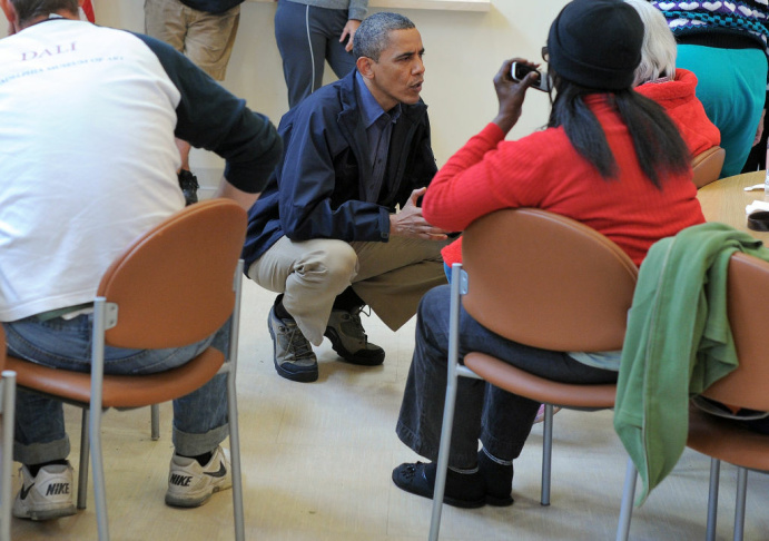 US President Barack Obama talks to Sandy victims at a shelter in Brigantine, New Jersey on October 31, 2012.