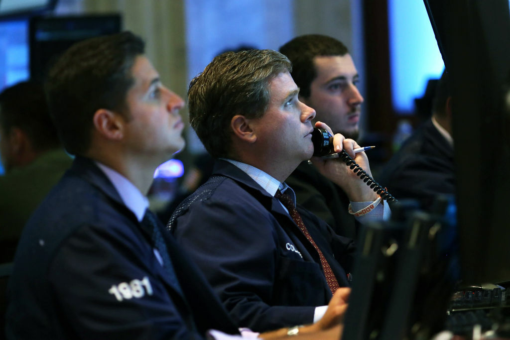Traders work on the floor of the New York Stock Exchange on August 1, 2012 in New York City.