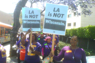 "Carrying ""L.A. is NOT Wisconsin'' signs and wearing purple T-shirts reading ""Clean Up Sodexo,"" more than 200 workers protested today outside the Board of Supervisors' meeting against a county proposal to award $11.2 million in hospital janitorial contracts to a company that union leaders claim would cut staff by as much as 30 percent."