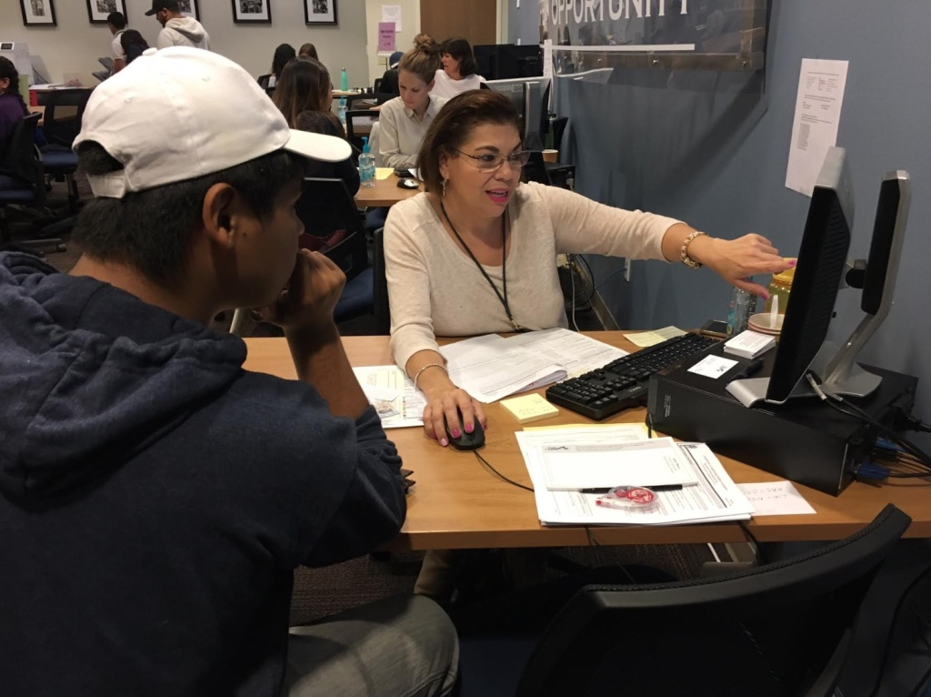 Aimee Meraz with Public Counsel in Los Angeles assists Cesar, 20, in filling out an application for renewal of his Deferred Action for Childhood Arrivals, or DACA, work permit and deportation protection.