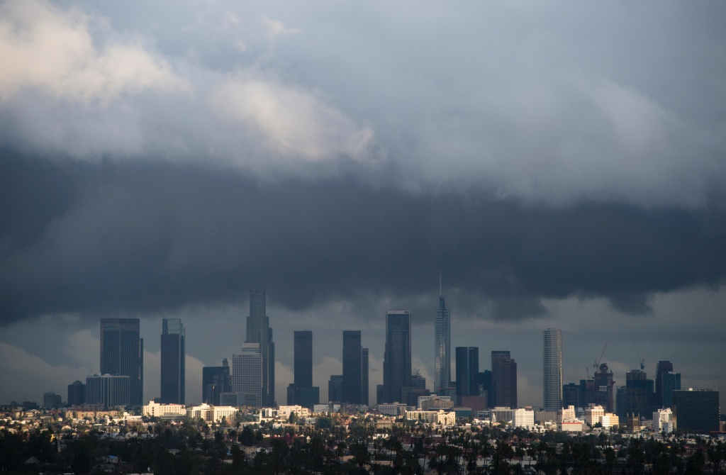 Rain clouds move over downtown Los Angeles, California on January 12, 2017.