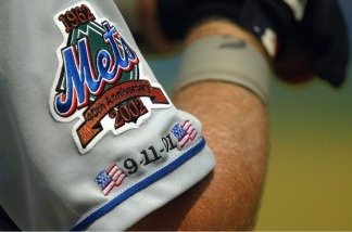 A member of the New York Mets wears a jersey commemorating the 40th anniversary of the club and the first anniversary of the terror attacks of 2001 on September 11, 2002. For then 10th anniversary, Mets players were stopped from wearing commemorative 9/11 hats.