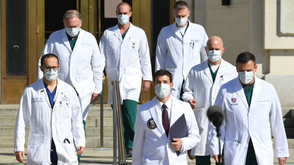 White House physician Sean Conley (center) arrives to answer questions surrounded by other doctors for an update on President Trump's health on Monday.
