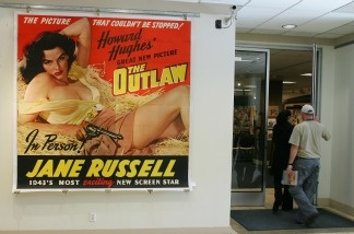 An original poster from the 1943 movie 'The Outlaw' staring Jane Russell is one display at Bonhams & Butterfields auction house in Los Angeles on Dec. 14, 2006, during the preview of their upcoming Entertainment Memorabilia Auction.