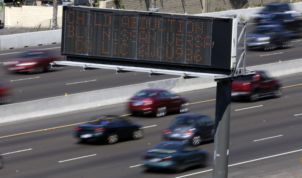 Drivers pass a display showing an Amber Alert, asking motorists to be on the lookout for a specific vehicle Tuesday, Aug. 6, 2013, in San Diego