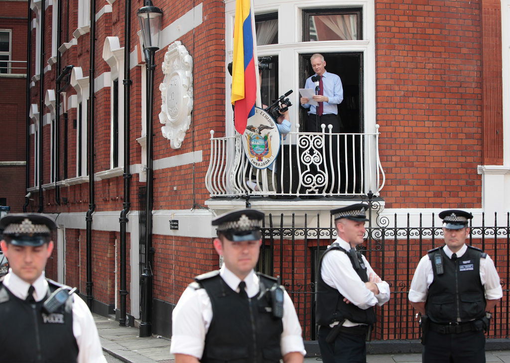 Wikileaks founder Julian Assange speaks from the balcony of the Equador embassy in Knightsbridge on August 19, 2012 in London, England. Mr. Assange is currently living inside Ecuador's London embassy after being granted political asylum whilst facing extradition to Sweden to face allegations of sexual assault. It has been suggested by Ecuador's president Rafael Correa that Mr Assange may co-operate with Sweden if they promised that he would not be extradited to a third country.