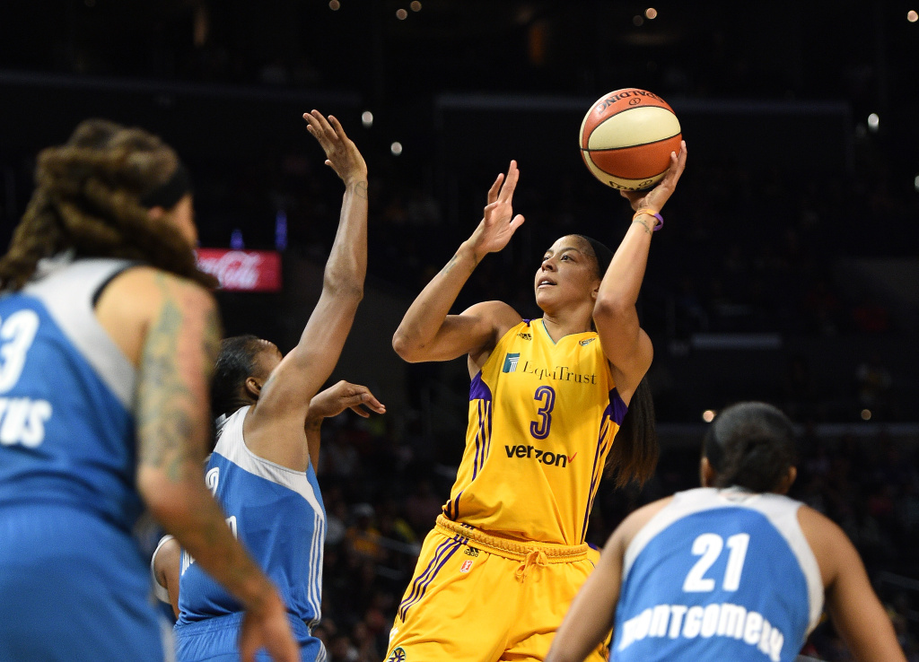 Candace Parker of the Los Angeles Sparks shoots over Rebekkah Brunson and Renee Montgomery of the Minnesota Lynx during the first half of Game Three of the 2017 WNBA Finals.