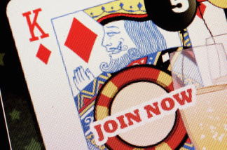 In this photo illustration a 'join now' button is displayed on a screen on an online gambling website on August 7, 2006 in London.