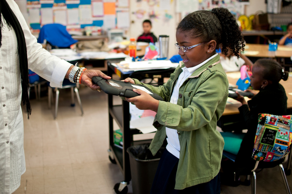 Second grade teacher Jacqueline Porter-Morris hands out iPads to her students at Baldwin Hills Elementary.
