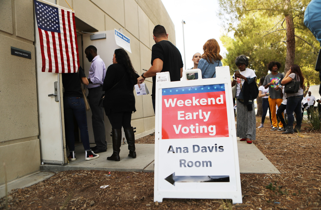 LANCASTER, CA - NOVEMBER 04:  Voters wait in line at a polling place to participate in early voting in California's 25th Congressional district on November 4, 2018 in Lancaster, California. Republican incumbent Rep. Steve Knight (CA-25) is competing against Democratic congressional candidate Katie Hill for his seat in the district. Democrats are targeting at least six congressional seats in California, currently held by Republicans, where Hillary Clinton won in the 2016 presidential election. These districts have become the centerpiece of their strategy to flip the House and represent nearly one-third of the 23 seats needed for the Democrats to take control of the chamber in the November 6 mid term elections.  (Photo by Mario Tama/Getty Images)