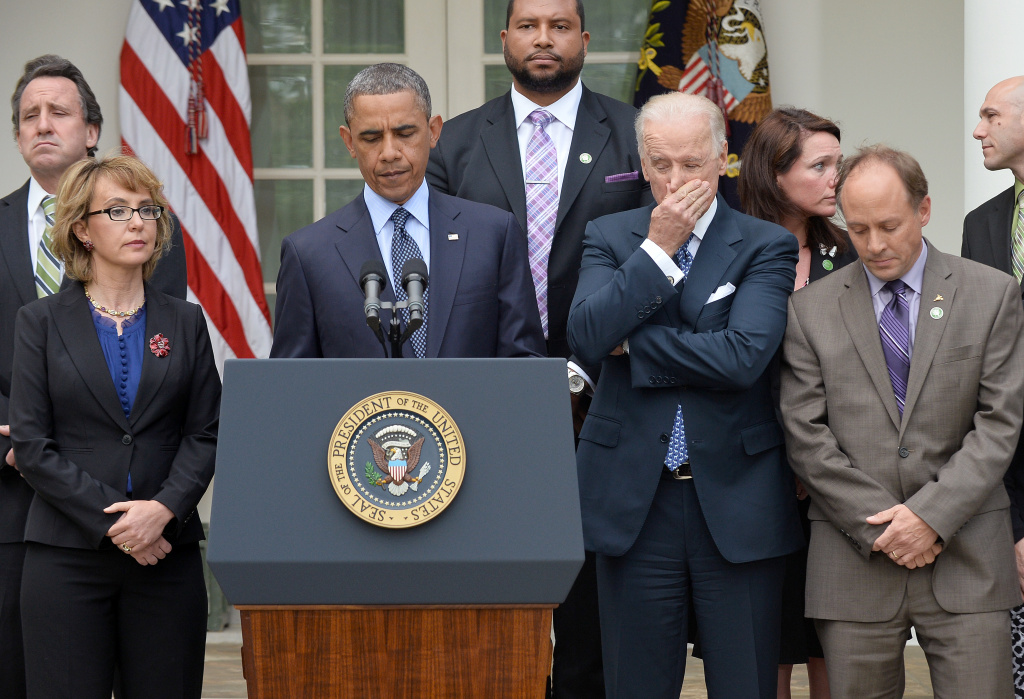 US President Barack Obama is accompanied by former lawmaker Gabrielle Giffords (L), vice president Joe Biden (R) and family members of Newtown school shooting victims as he speaks on gun control at the Rose Garden of the White House in Washington, DC, on April 17, 2013.
