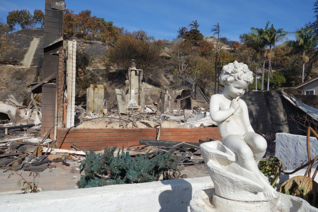 A cherub statue is unharmed despite the destruction of the house it decorated in the Clearpoint neighborhood of Ventura, during the Thomas Fire.