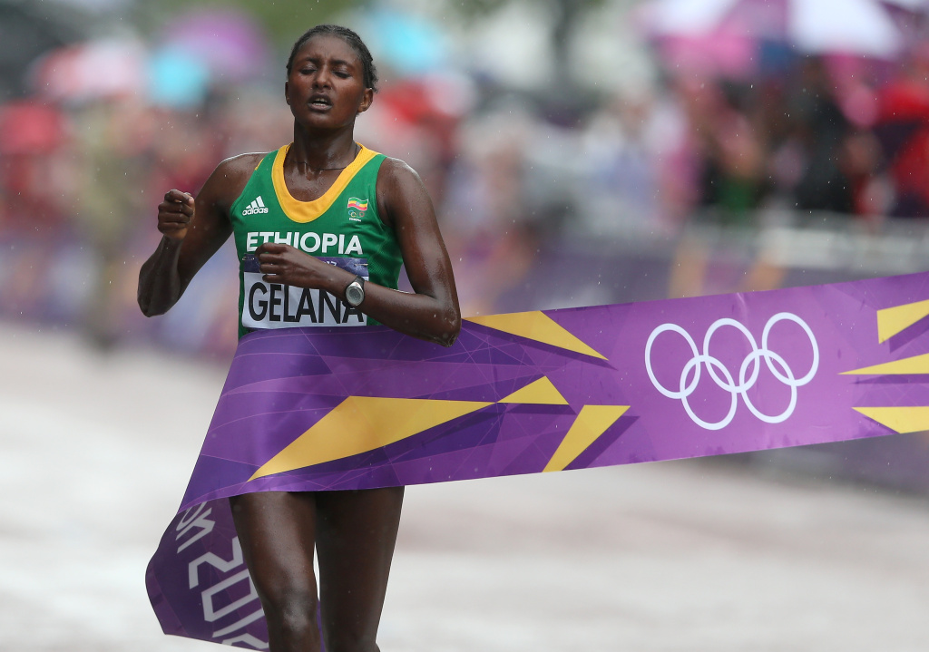 Tiki Gelana of Ethiopia celebrates as she crosses the finish line to win the gold medal in the Women's Marathon at The Mall on Day 9 of the London 2012 Olympic Games on Aug. 5, 2012 in London, England.