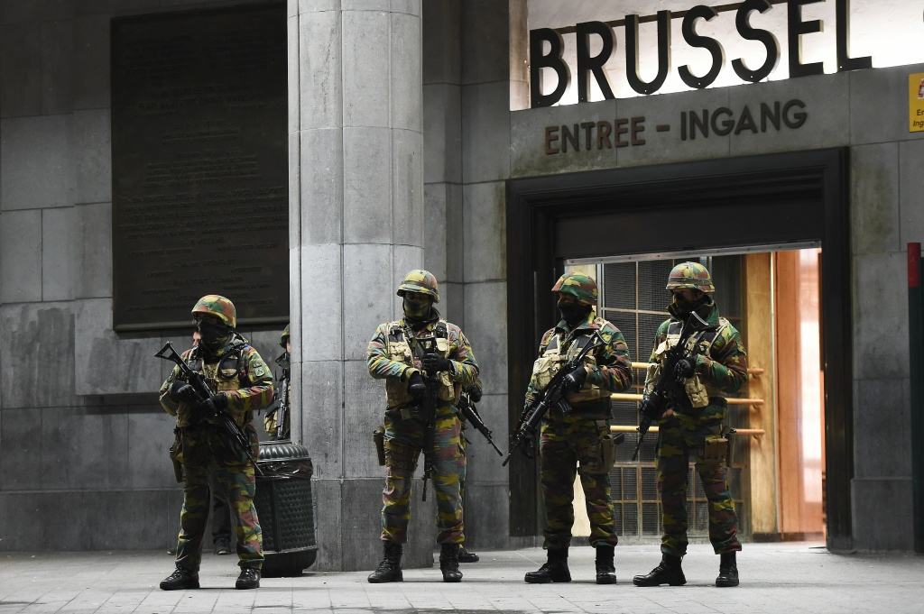 Soldiers stand guard in front of the central train station on November 22, 2015 in Brussels, as the Belgian capital remained on the highest security alert level over fears of a Paris-style attack.