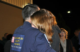 Mikael Gartner and girlfriend Laura Drost embrace after being apart for the longest amount of time in their one-year relationship, 16 days. Gartner was on the Urban Search and Rescue task force that deployed for Haiti on Jan. 13, 2010.