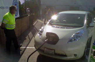 AAA worker Allan Stanley recharges a Nissan Leaf at the motor club's headquarters in Los Angeles.