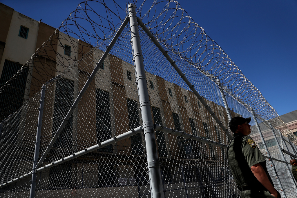 An armed California Department of Corrections and Rehabilitation (CDCR) officer stands guard at San Quentin State Prison's death row on August 15, 2016 in San Quentin, California.